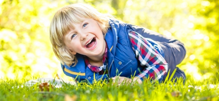 A family photo shoot outdoors in Cobham, Surrey